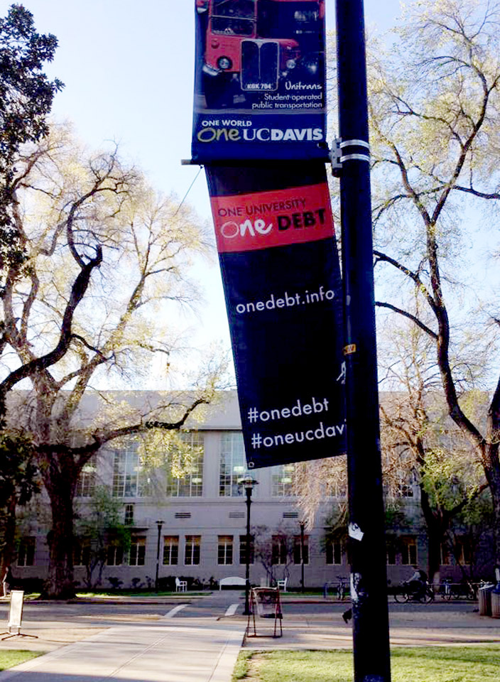 """One Debt"" banner, art exhibition class"