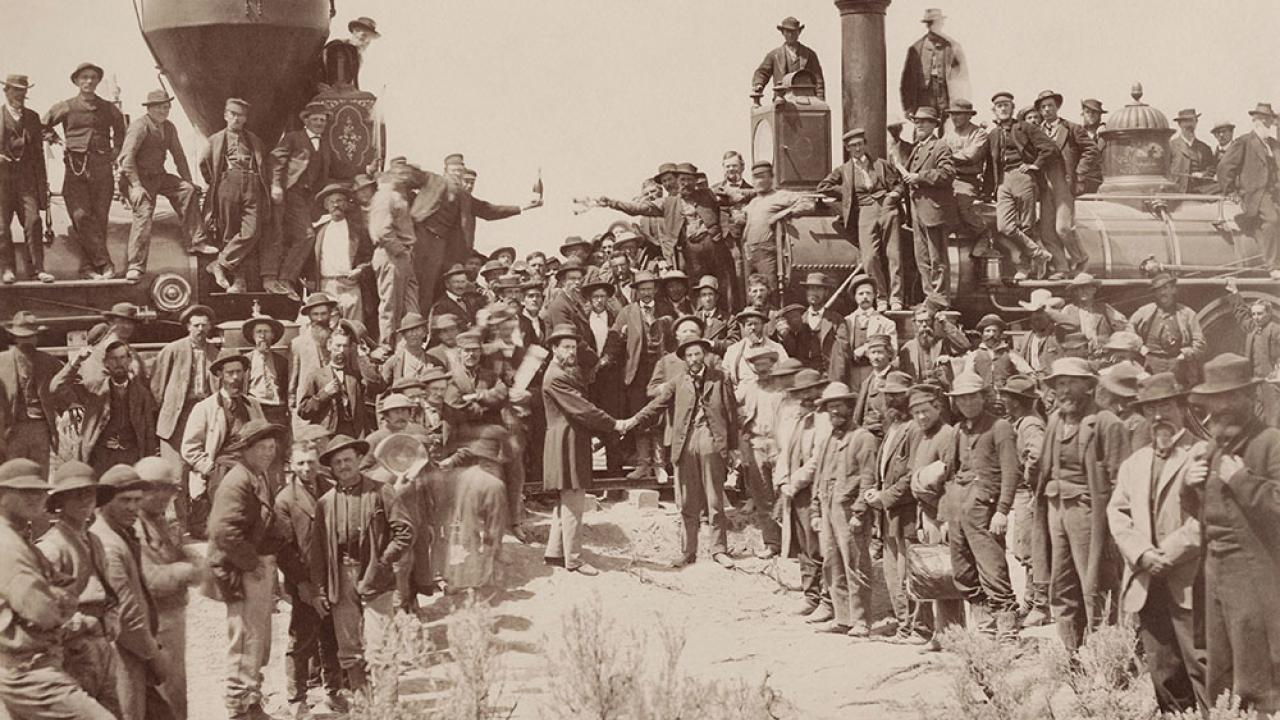historic photo of last spike ceremony for transcontinental railroad